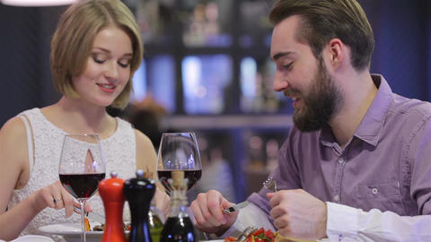 Beautiful couple having romantic dinner at restaurant Live Action