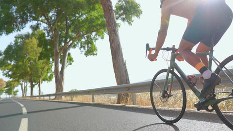 A man ride on bike on the road. Sport and active life concept sunset time. A man Footage