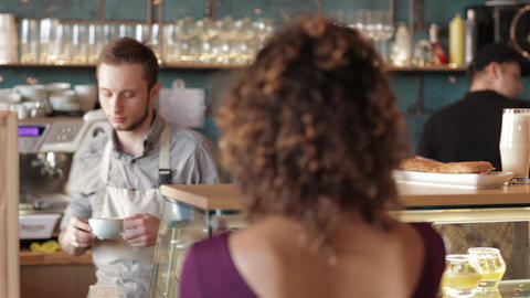 Barista gives young girl a fragrant latte Live Action