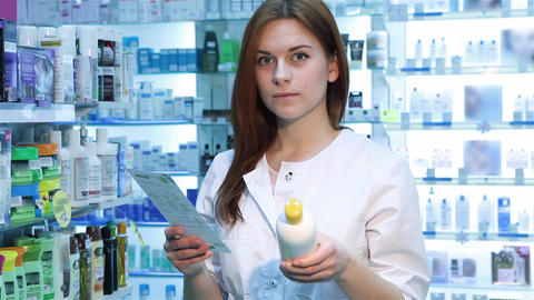 Pharmacist woman standing with recipe Footage