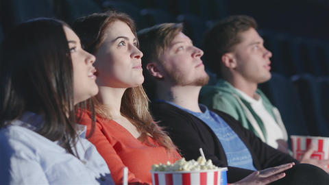 Four friends in a multiplex view perspective Live Action