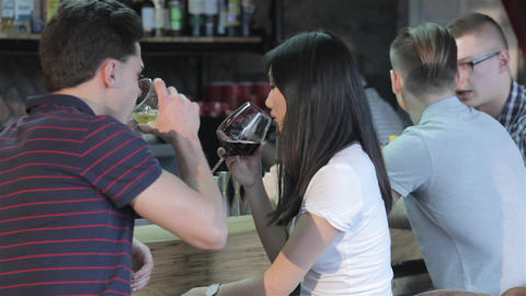 Asian girl drinks red wine while man drinks whiskey Footage