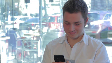 Close up of man uses cellphone at the cafe Footage