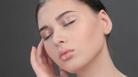 Close up of brunette girl with closed eyes Live Action