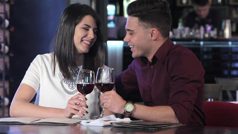 Couple clink their glasses Footage