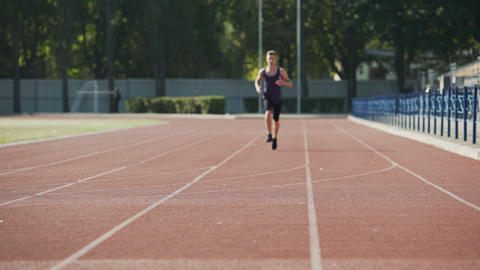 Man doing sports, running circles at stadium, daily workouts, active lifestyle Footage
