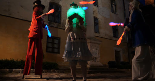 4k Alice in wonderland - performance with jugglers, led lights, stilts and magic 영상물