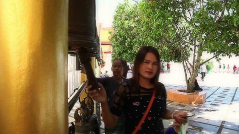 Prayers in Wat Prathat Doi Suthep pagoda bangs bell, Chiang Mai city , Thailand Footage