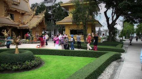 Visitors at Wat Rong Khun temple Live Action