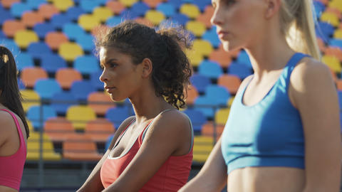 Beautiful ladies doing physical exercises at stadium,… Stock Video Footage
