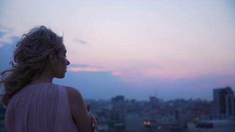 Lonely girl peering at sunset remembering and yearning for past, loneliness Live Action