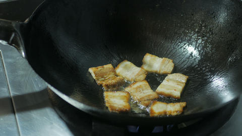 Bacon frying in a pan Live Action