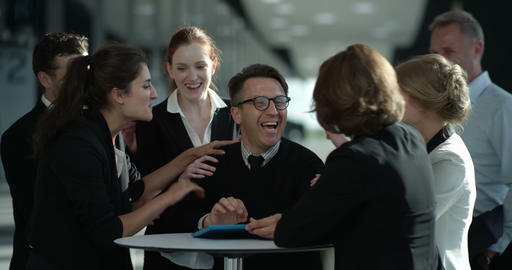 Business people congratulating coworker Live Action