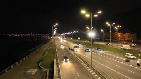 Multiband highway in big city with going cars in night. Cars drive on highway Live Action