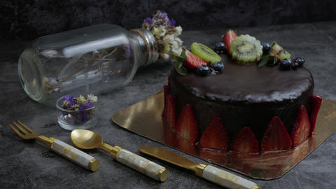 sweet pastry dessert chocolate cake with strawberry, kiwi and blueberry set on GIF