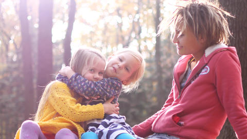Mom with little girls on a picnic in the autumn forest Footage