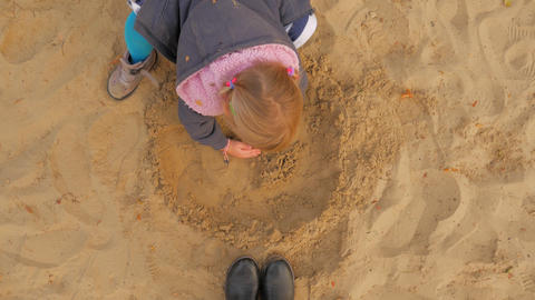 The Girl Is Playing In The Sandbox. The Sandbox, A Little Blonde Sculpts Live Action