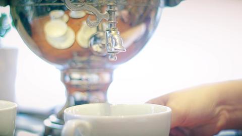 Samovar pouring boiling tea close-up Live Action