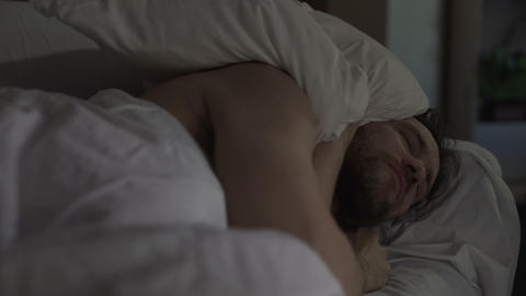 Annoyed man tossing and turning in bed unable to fall asleep, noisy neighbors Live Action