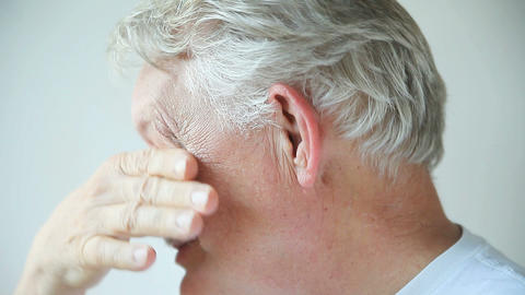 Man with stuffy nose, itchy eyes Footage