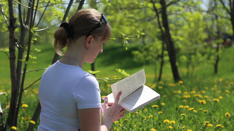 Girl reading a book Footage