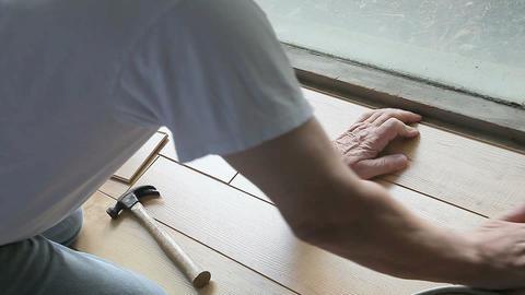 Fitting laminate flooring next to window Footage