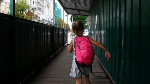 Little girl having fun jumping. Girl run to school ビデオ