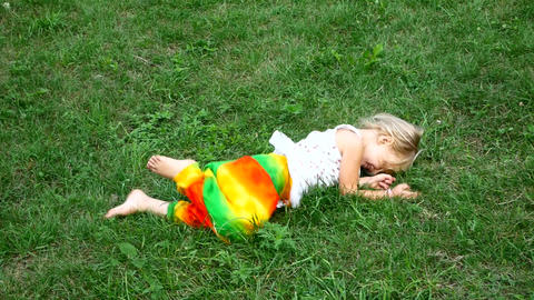 The girl lying on the grass. Emotions smile Stock Video Footage
