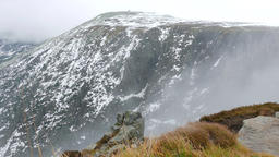 Clouds moving over granite walls of Snowy Cirque at winter, Karkonosze mountains Footage