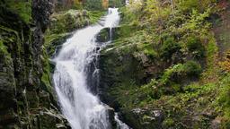 Kamienczyk Waterfall at fall. Karkonosze National Park, UNESCO biosphere reserve Live Action