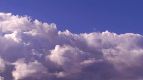 Fluffy Clouds Gather In a Colorful Sky Footage