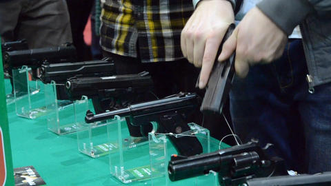 Several large-caliber weapons on the table Live Action