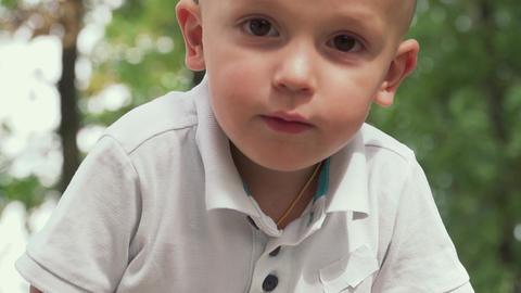 Face of a little boy close up Live Action