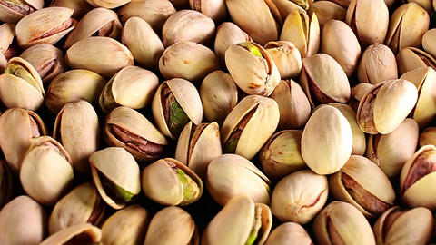Pistachio texture. Nuts. Green fresh pistachios as texture. Roasted salted Footage