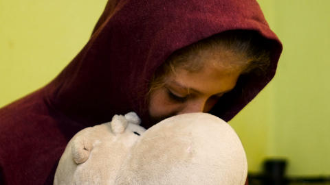 teen holds a stuffed toy because depressed Live Action