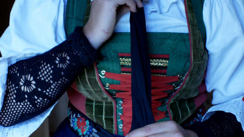 girl dresses a complex Tyrolean dress, typical of the traditional alpine areas Footage