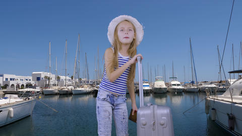 Tourist girl with travel suitcase waiting ship in sea port on yacht background Live Action