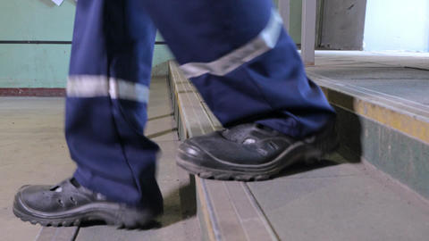 Workers in work shoes Footage