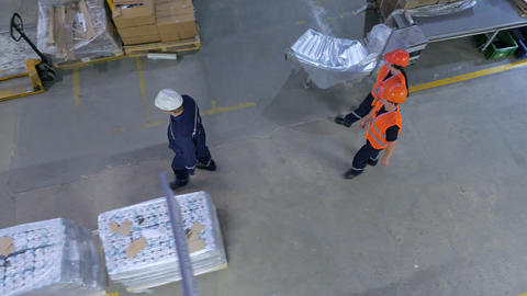 A group of workers in overalls GIF