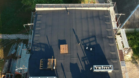 Flat house roof in city after renovation, aerial view Live Action