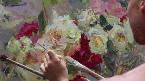 Close up of man's hand painting still life picture on canvas in art studio Live Action