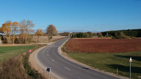 Autumn time asphalt road and agriculture fields, aerial view Live Action