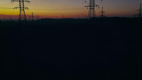 View from the height of power line silhouettes against... Stock Video Footage