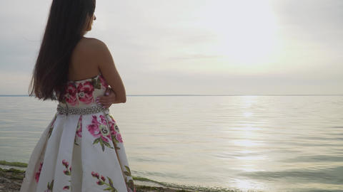 Romantic girl in a long dress by the river Footage