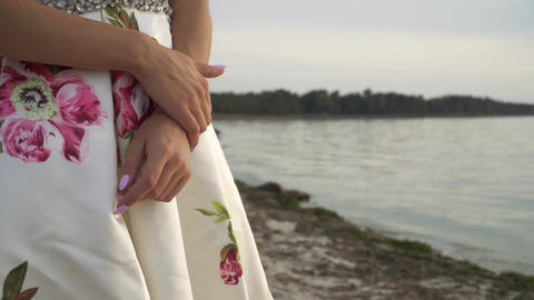 Romantic woman in evening dress by the river Stock Video Footage