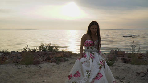 Charming girl in evening dress by the river Footage