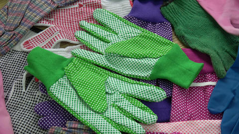 Rotating various protective glove background Live Action