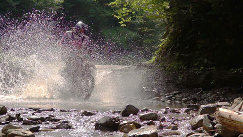 Motocycle Rider Crosses Mountain River Footage