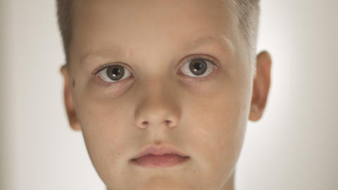 Portrait Of Handsome Expressive Little Boy Moving His Eyebrow GIF