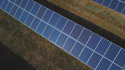 Solar panels with sun light shining. Shot on drone Footage